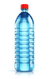 Blue plastic drink water bottle. Blue plastic bottle with clear purified drink carbonated water isolated on white background with reflection effect Stock Photos