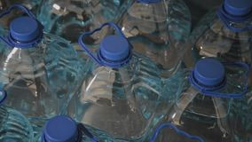 Blue plastic drinking water bottles in large quantities. stock footage