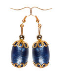 Blue plastic earrings with gold elements on a white background Royalty Free Stock Photo