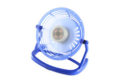 Blue plastic frame electric fan spinning Royalty Free Stock Photography