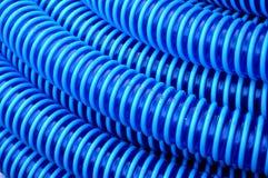 Blue plastic hose background Stock Images
