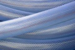 Blue plastic hose background Royalty Free Stock Photos
