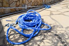 Blue plastic long large corrugated hose for cleaning the pool wash and watering the plants.  stock image