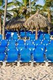 Blue plastic Lounges on white sand beach Stock Photos