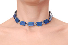 Blue plastic necklace on neck Royalty Free Stock Photos