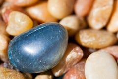 Blue Plastic Pebble Stock Photo