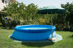 Blue plastic pool Stock Image
