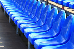 Blue plastic seat in street scene Stock Image