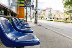 Blue plastic seats in bus stop,soft focus Royalty Free Stock Image