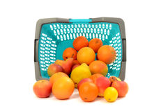 Blue plastic shopping basket full of fruits. Royalty Free Stock Photo