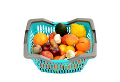 Blue plastic shopping basket full of groceries. Royalty Free Stock Photos