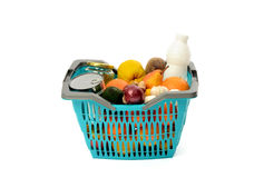 Blue plastic shopping basket full of groceries. Stock Photo