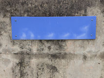Blue plastic sign Stock Images