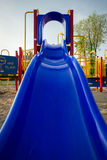 Blue Plastic Slide at Playground Royalty Free Stock Photography