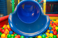 Blue plastic slide and pool Stock Photography