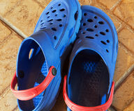 Blue plastic slippers Stock Image