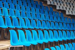 Blue plastic stadium seats Stock Photo