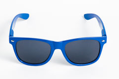 Blue plastic sunglasses isolated on white Royalty Free Stock Photo