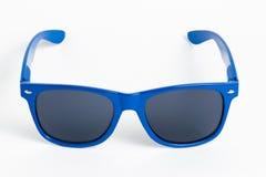 Blue plastic sunglasses isolated on white. Background Royalty Free Stock Photo
