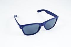 Blue plastic sunglasses Royalty Free Stock Photo