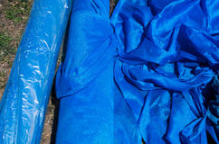 Blue plastic tent on the ground. Royalty Free Stock Images
