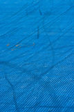 Blue plastic texture playground with trails on it. Royalty Free Stock Photo