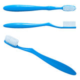 Blue plastic toothbrush, the top view, sideways and in the long term Stock Photography