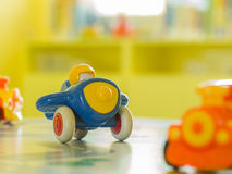 Blue plastic toy airplane and another toy on a table Stock Photo