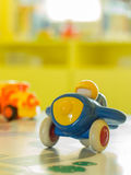 Blue plastic toy airplane and another toy on a table Stock Photography