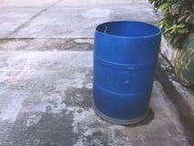 Blue Plastic Trash Bin on the Floor. Blue Plastic Trash Can on the Floor Stock Photos