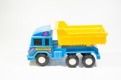Blue plastic truck toy with yellow pickup Stock Photography