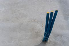 Blue plastic tubes and piping for electrical wiring and concrete floor building foundation. A close up view of blue plastic tubes and piping for electrical Stock Image