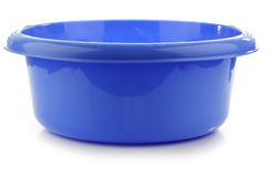 Blue plastic wash bowl. On a white background Stock Photography