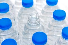 Blue plastic water bottles. Water help to quench their thirst an. D heat Royalty Free Stock Images