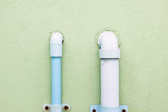 Blue plastic water pipe on the wall. Water pipe Royalty Free Stock Photography