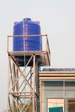 Blue plastic water tank on the tower. Blue water tank on the tower Stock Image