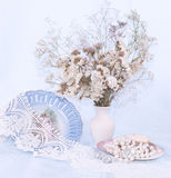Blue plate, beads and flowers Stock Images