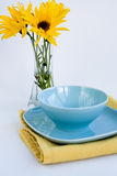 Blue plate and bouquet of flowers Stock Image