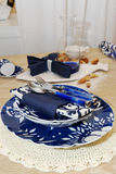 Blue plate with cutlery. On the kitchen table Royalty Free Stock Photo