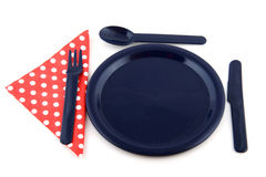 Blue plate with dotted napkin Royalty Free Stock Photo