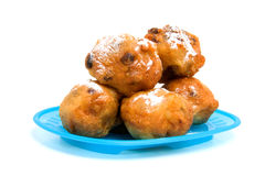 Blue plate with Dutch donut asa oliebollen Royalty Free Stock Photos