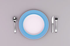 Blue Plate with fork, knife and spoon Royalty Free Stock Images