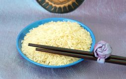 Blue plate with rice and chopsticks Royalty Free Stock Photography