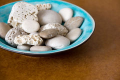 Blue Plate and Stones Royalty Free Stock Photos