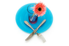 Blue plate and table utensils Stock Photos