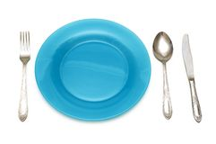 Blue plate and table utensils Royalty Free Stock Photos