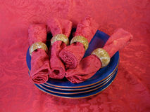 Blue plates on brocade Royalty Free Stock Images