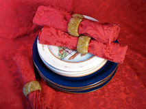 Blue plates on brocade Stock Images