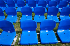 Blue platform seats on grass Royalty Free Stock Photography