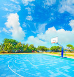 Blue playground under clouds Royalty Free Stock Photography